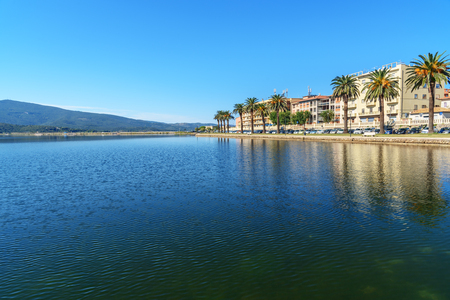 Waterfront of Orbetello on peninsula Argentario in Tuscany. Italy Imagens - 115664947