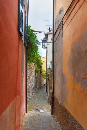Old narrow street in Portovenere or Porto Venere town on Ligurian coast. Province of La Spezia. Italy