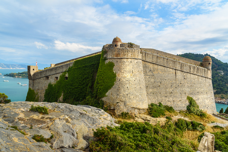 View of Castle Doria and St. Peter in Portovenere or Porto Venere town on Ligurian coast. Province of La Spezia. Italy 報道画像