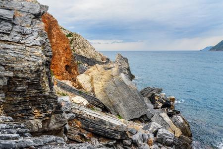 Rocky sea coast in Portovenere or Porto Venere town on Ligurian coast. Province of La Spezia. Italy