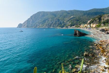 View of beach with cliff in Monterosso al mare in coastline of Liguria. Cinque Terre. Italy