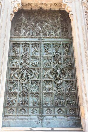 Door of Cathedral Or Duomo Di Milano in Milan. Italy
