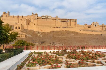 View of Amber fort and palace from Kesar Kyari Bagh garden on Maotha Lake. Jaipur. Rajasthan. India