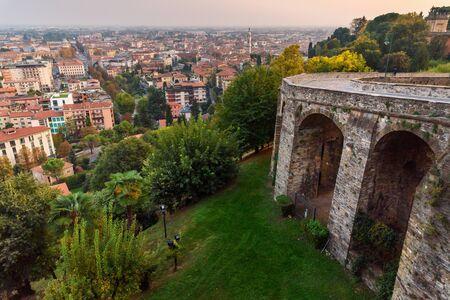 View of Bergamo city and old bridge on Via Sant Alessandro street to upper city Cita Alta at sunset. Bergamo. Italy