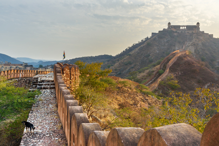 Ancient long wall with towers around Amber Fort, and view of Jaigarh Fort. Jaipur. Rajasthan. India