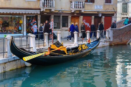 Venice, Italy - October 23, 2018: Gondola at canal Rio Della Maddalena