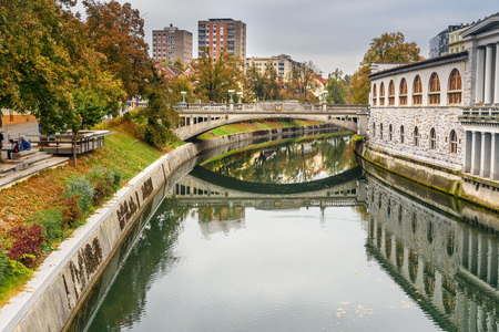 View of Ljubljanica river and Dragon Bridge or Zmajski most in Ljubljana. Slovenia