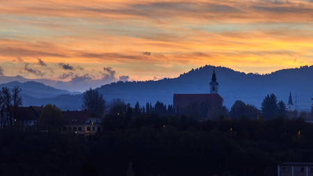 View of church of St. Martina on hill on sunset in Kranj. Slovenia Stockfoto