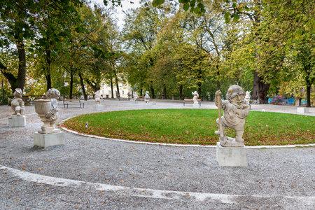 Salzburg, Austria - October 29, 2018: Dwarf statues in Dwarf Garden. Mirabellgarten or Mirabell garden is garden of Mirabell Palace
