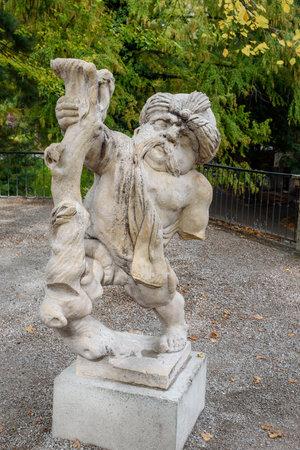 Salzburg, Austria - October 29, 2018: Dwarf with turban in Dwarf Garden. Mirabellgarten or Mirabell garden is garden of Mirabell Palace