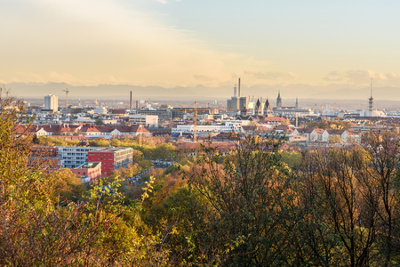 View on Munich city from Park on sunset. Germany