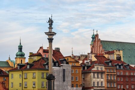 Sigismund's Column ang houses and churches in old town of Warsaw. Poland