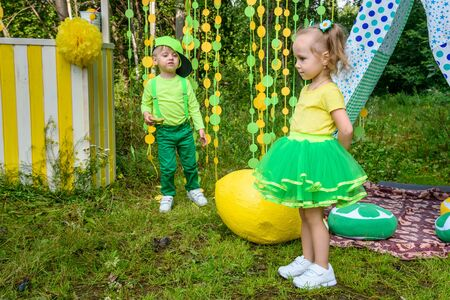 Children on colorful background in park in summer day Фото со стока - 130360241