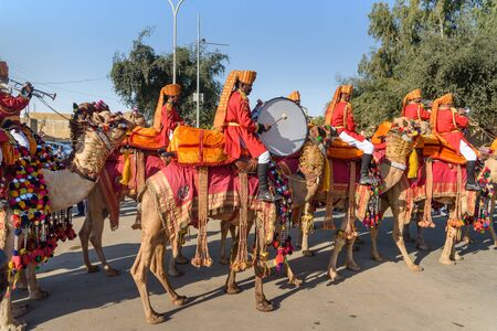 Jaisalmer, India - February 17, 2019: Ceremonial procession Camels and riders in Desert Festival in Jaisalmer. Rajasthan Editorial