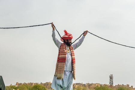 Jaisalmer, India - February 17, 2019: Indian man with beard and long mustache wearing traditional clothes in Desert Festival in Jaisalmer. Rajasthan Editorial