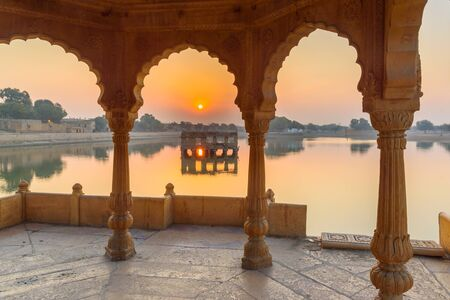 Gadisar lake in the morning at sunrise. Man-made water reservoir with temples in Jaisalmer. Rajasthan. India