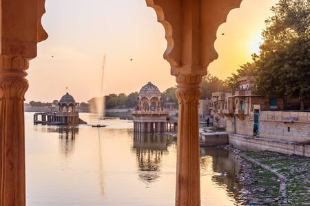 Gadisar lake on sunset. Man-made water reservoir with temples in Jaisalmer. Rajasthan. India