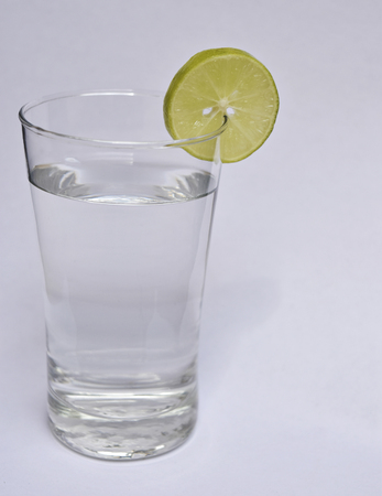 longdrink: glass with water and lemon in white background Stock Photo