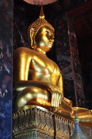 subduing: Golden Buddha, The attitude of subduing Mara in Bangkok Stock Photo