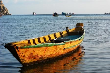 The boat anchored near the shore photo