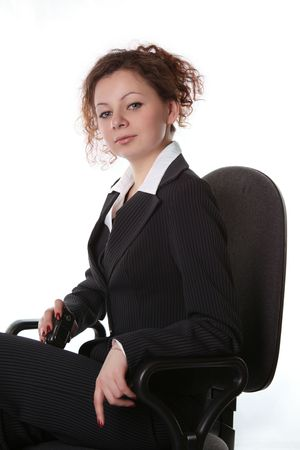 Girl with a mobile phone is sitting in an office chair Stock Photo - 3751787