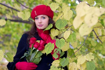 Girl with red roses in park photo