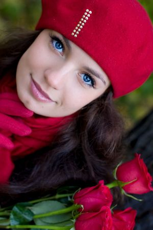 Girl with red roses in park Stock Photo - 3751790