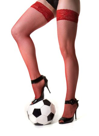 Girl in red stockings keeps foot on ball Stock Photo - 4222688