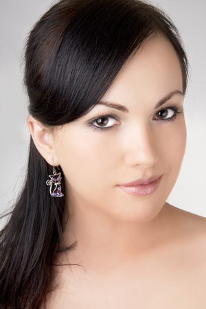 Image of the brunette girl with a beautiful earring.