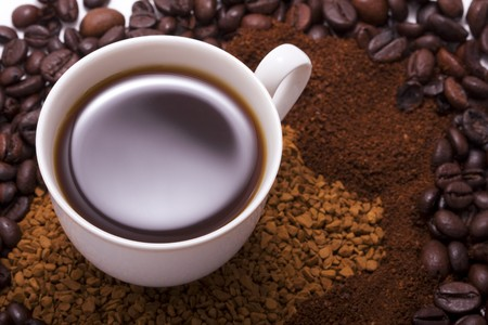 Picture a cup of coffee which is at the coffee beans photo