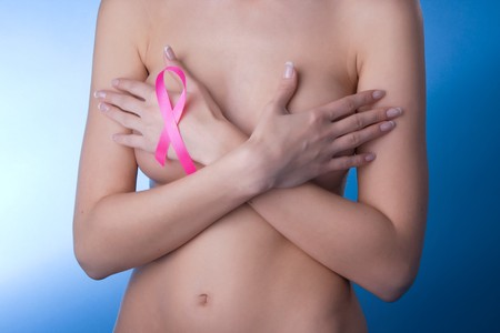 Image of a girl with a pink ribbon in her hand