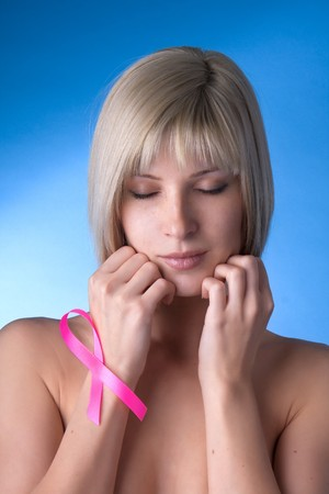 Image of a girl with a pink ribbon in her hand photo