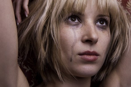 Image of a beautiful blonde in tears photo