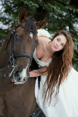 Image of a girl in a white dress on a horse Stock Photo