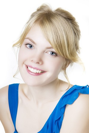 Picture of smiling blond girl in blue photo