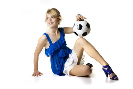 Image of the blond girl in a blue dress with soccer ball Stock Photo - 4414291