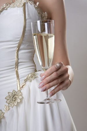 french manicure sexy woman: Image of hand holding a glass