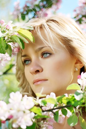 Picture of a beautiful girl in a flowering garden photo