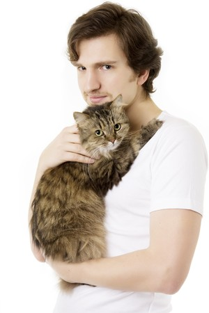 Picture of a young man who keeps on hand fluffy cat