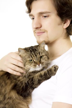 Picture of a young man who keeps on hand fluffy cat photo