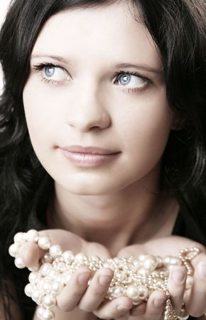 Picture of beautiful girl model rope of pearls in the hands of Stock Photo - 4636444
