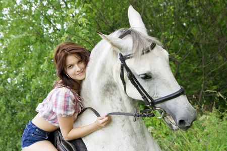 The image of a beautiful brunette girl with horse Stock Photo - 5227447