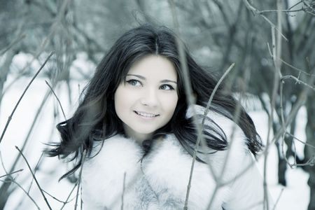 The image of a beautiful girl in the background of a winter city Stock Photo - 5804090