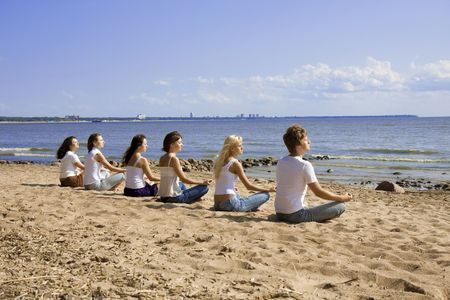 Image of a group of people sitting on the beach Stock Photo - 5804102