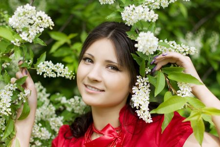 Image of a beautiful girl with spring flowers in the park photo