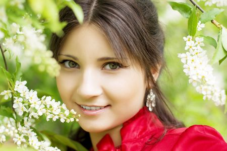 Image of a beautiful girl with spring flowers in the park Stock Photo - 5804091