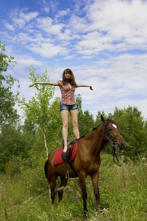 cute young farm girl: The image of a beautiful brunette girl with horse