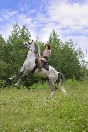bridle: The image of a beautiful brunette girl with horse