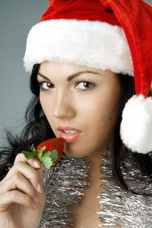 Image of Santa girl with strawberries photo