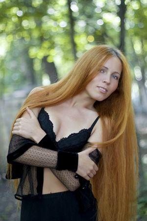 Abstract photo of a girl with long  hair in an outdoor photo